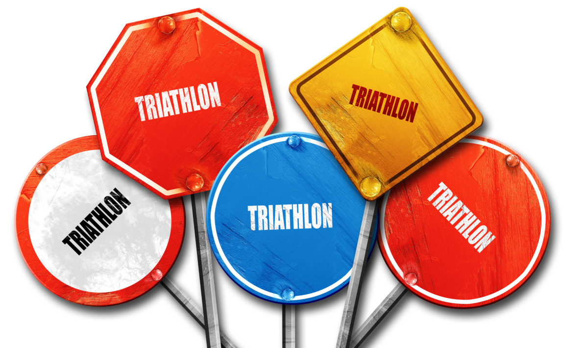 a boquet of signs that read 'triathlon'